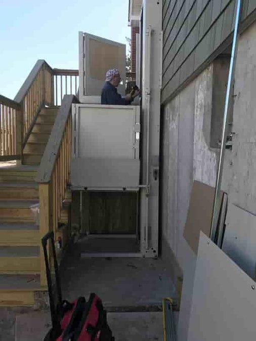 bruno platform lift being installed outside of long island home